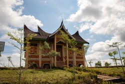 Malay traditional house in the Taman Budaya area, bright daylight. Tanjungpinang, Riau Islands, Indonesia