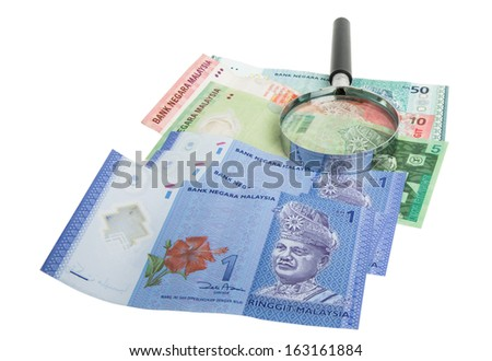 Malaysia bank notes money with magnifying glass #163161884