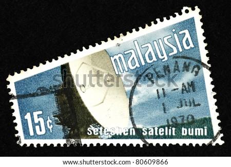 MALAYSIA - CIRCA 1970: Stamps printed in Malaysia showing a large satellite dish, circa 1970.