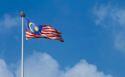 Malaysia flag also known as Jalur Gemilang waving with the blue sky background. In conjunction of Independence Day or Merdeka Day celebration on 31 August and Hari Malaysia on 16 September.
