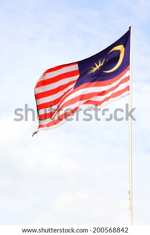 Malaysia flag waving on the wind flew over the blue sky