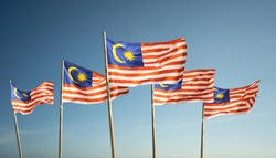 malaysia flags under blue sky independence day concept