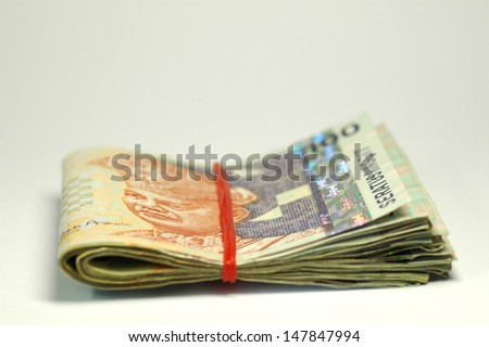 Malaysia money with rubber band