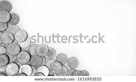 Malaysian 50 cents coins on the bottom left corner of white background. Malaysian coin currency border.