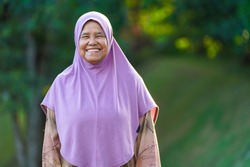Malaysian face for 2020. Muslim woman in hijab portrait at a park