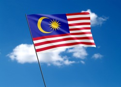 Malaysian flag flying high in the sky Malaysian independence day. World national flag collection