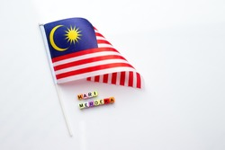 Malaysian flag with alphabet dice assemble to spell malay words