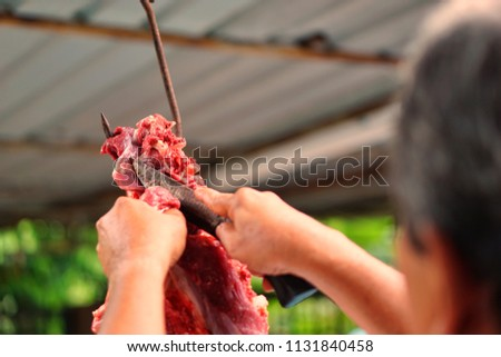 Malaysian Muslims help each other prepare halal slaughtering during Eid Al-Adha Al Mubarak, the Feast of Sacrifice or Qurban. Selective focus. #1131840458