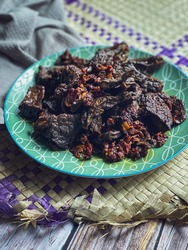 """Malaysian tradisional dishes called """" Paru Berlado"""" it is covered with red chilli paste. It is popular eat with nasi lemak or white rice."""