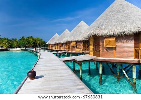 Maldives. A wooden road over ocean