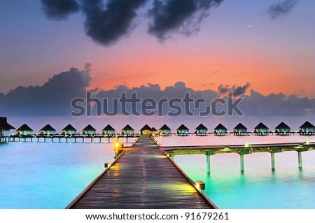 Maldives bungalows sunset
