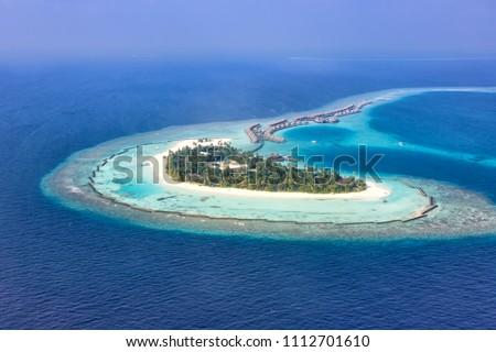 Maldives island vacation paradise sea copyspace Halaveli Resort Ari Atoll aerial photo tourism