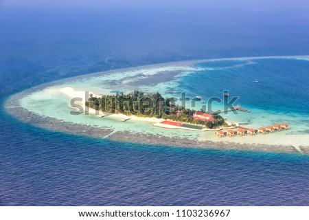 Maldives island vacation paradise sea copyspace Maayafushi Resort Ari Atoll aerial photo tourism