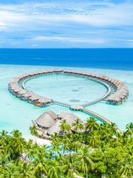 Maldives paradise scenery. Tropical aerial landscape, seascape with long jetty, water villas with amazing sea and lagoon beach, tropical nature. Exotic tourism destination banner, summer vacation