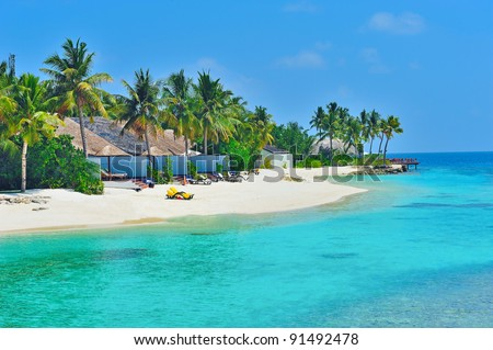 Maldives water villa - bungalows and white beach