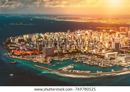 Maldivian capital from above at sunset #769780525