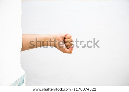 male adult hand showing fist gesture - gesture and body parts concept #1178074522
