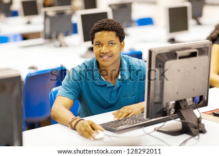 male african college student in computer room