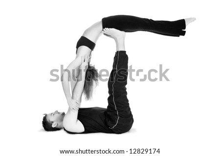 male and female gymnasts practicing a complex double yoga