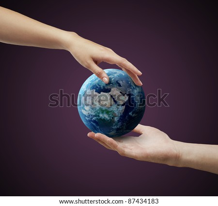 Male and female hand holding earth. Conceptual symbol of the Earth with human hands.