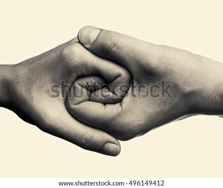 male and female hands connected ...
