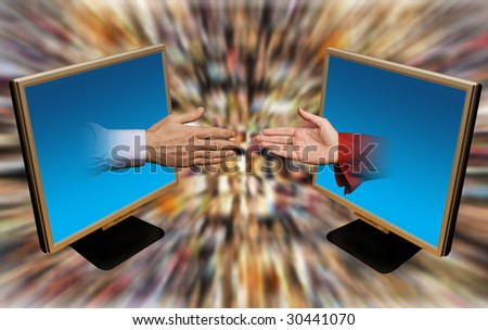 male and female hands reaching out of laptop monitors with people faces blurred in background