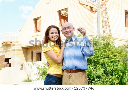 male and female   happy house  green outdoors building