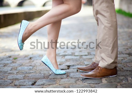 Male and female legs during a date - stock photo