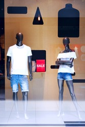Male and female mannequin in shop window
