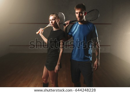 Male and female squash game players with rackets ストックフォト ©
