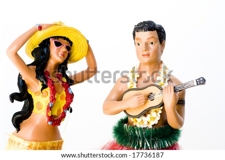 Male and female vintage traditional Hawaiian souvenir Hula figures
