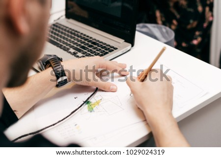 male architect architect working on project in office