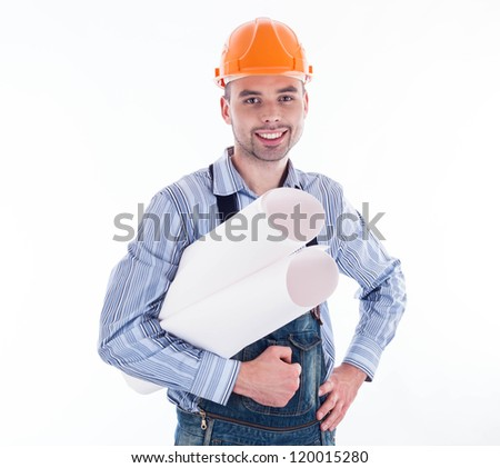 Male architect looking at blueprints against white background