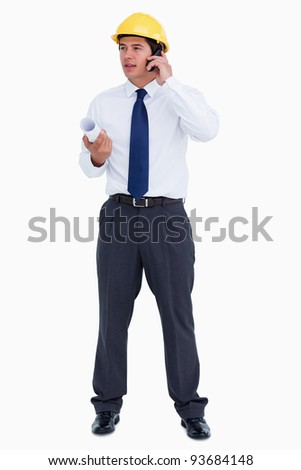 Male architect on his cellphone against a white background