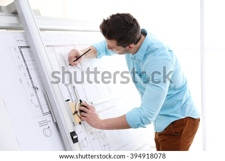 Male architects working on blueprints #394918078