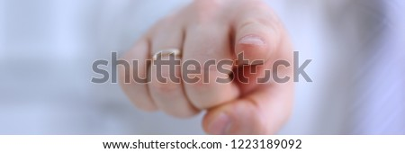 Male arm point forefinger to you or camera during conference conversation in office closeup. Suggestion illustrate offer proposition bribe demand boss advisor idea concept #1223189092