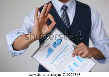 Male arm show OK or confirm during conference in office closeup. High level and quality product offer, okay symbol expression, perfect mediation solution, happy client, creative adviser participate