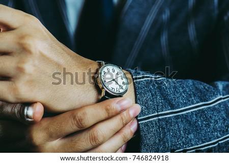 Male arm wearing a wrist watch
