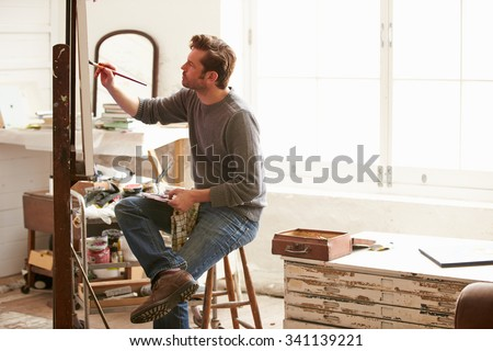 Male Artist Working On Painting In Studio #341139221