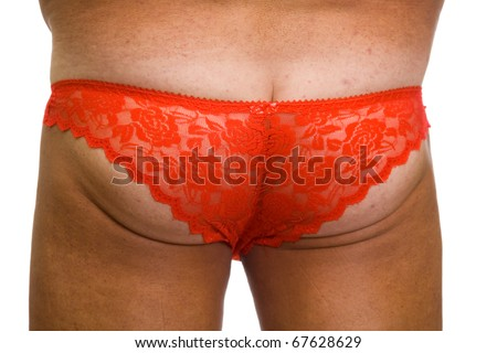 Male ass in red fishnet women's panties on a white background