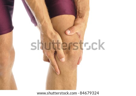 Male athlete in pain clutches his knee