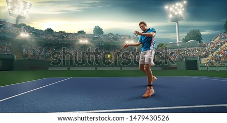 Male athlete plays tennis on a professional court