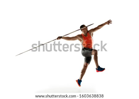 Male athlete practicing in throwing javelin isolated on white studio background. Professional sportsman training in motion, action. Concept of healthy lifestyle, movement, activity. Copyspace.