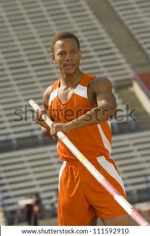 Male athlete preparing for pole vault