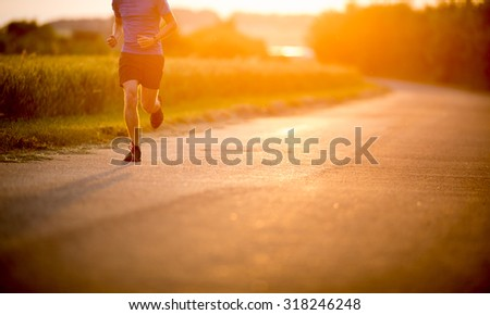 Male athlete/runner running on road - jog workout well-being concept Stock fotó ©