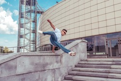 Male athlete, runs and jumps in jump, summer city, hip hop style, breakdancer. Free space for motivation text. Active youth lifestyle, modern fashionable hipster, street dancer. Fitness movement