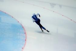 male athlete speed skater skate turn in ice-skating