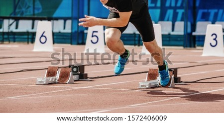 male athlete sprinter start 100 meters at athletics competition
