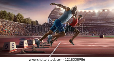 Male athletes sprinting. Three men in sport clothes run at the running track in professional stadium