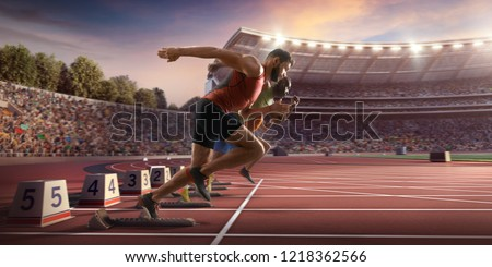 Male athletes sprinting. Two men in sport clothes run at the running track in professional stadium